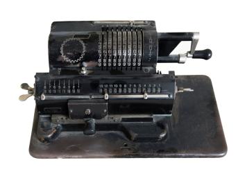 Old black adding machine isolated on white background