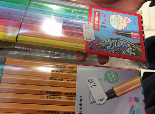 A set of pens and a set of pencils with price labels in euros